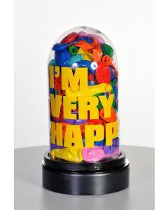 Erika Calesini, I'm Very Happy, Capsula in vetro con palloncini resinati, scritta gialla e base rotante, h28 cm