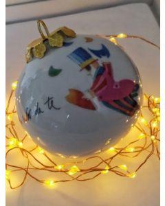 Francesco Musante, In volo da te con il cuore in mano, pallina di Natale in porcellana, h 7,5 cm