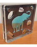 Renzo Nucara, Stratofilm (elefante su sfondo nero), Plexiglass, resine, oggetti, 10x10 cm, tratto dalla collezione The Gadget